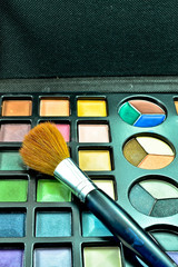 Multi colored make-up and brush