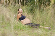 Pregnant woman relaxing in the grass