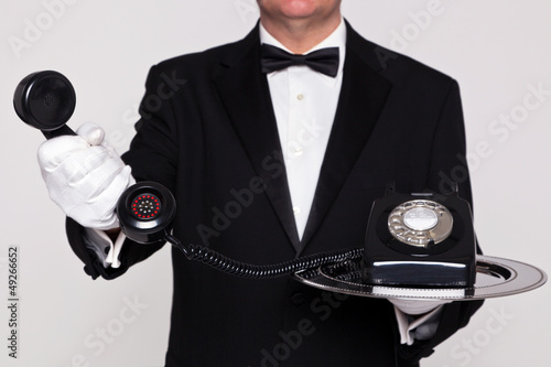 Butler handing you a telephone