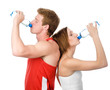 Athletic woman and man drink water. isolated on white