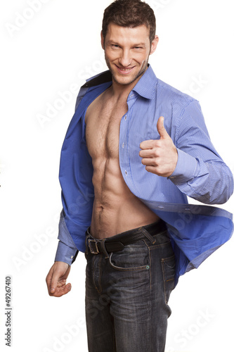 handsome athletic man posing and pointing with a blue shirt