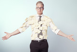 Miserable businessman covered by blank yellow stickers. poster