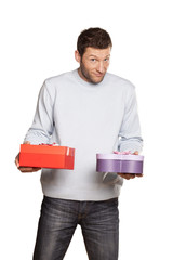 handsome guy in a blue blouse and jeans holding gifts