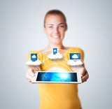 Young woman holding tablet with modern devices