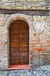 Wooden door. Castell'Arquato. Emilia-Romagna. Italy.