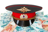 Russian police officer cap on the batch of banknotes