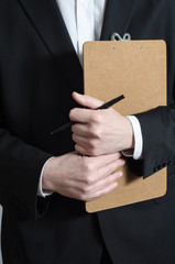 Suited Man with Clipboard