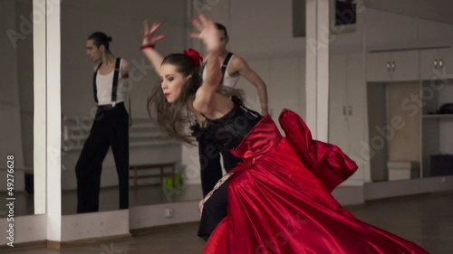 Professional dancers dancing in ballroom, super slow motion
