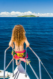 Young woman on a catamaran