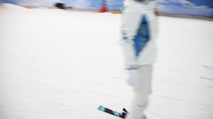 skier instructor with girl go down to ski on slope in close