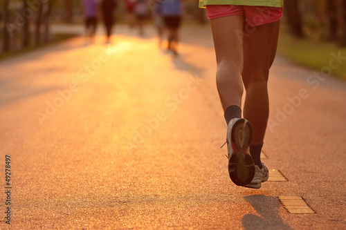 Feet of runner in evening light