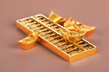 gold ingots and abacus