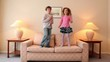 Two kids jump on sofa and then run away from room with lamps on