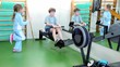 Two kids train in gym, boy haul training equipment and little