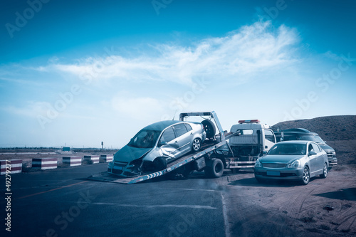 accident car on the tow truck - 49279277