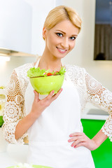 Beautiful young woman with vegetable salad. Dieting Concept.
