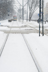 Approaching Tram in Heavy Snow.