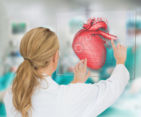 Doctor consulting touchscreen displaying heart diagram