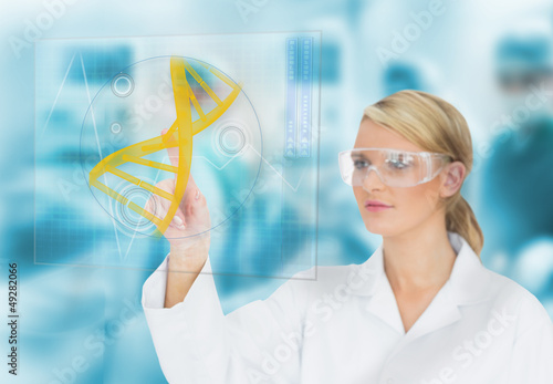 Doctor consulting DNA helix diagram on touchscreen display