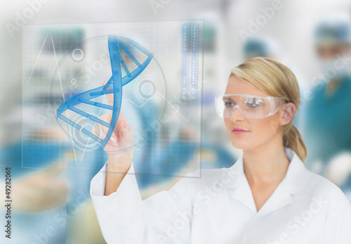 Doctor consulting touchscreen displaying DNA helix diagram