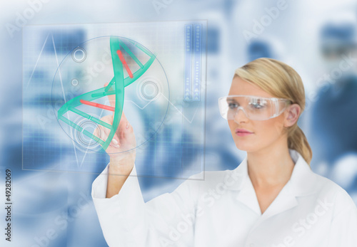 Doctor using touchscreen displaying DNA helix diagram
