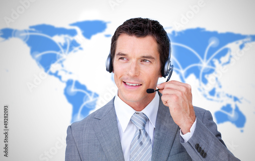 Smiling businessman using headset