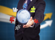 Businessman with colored puzzles and a globe