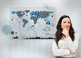 Businesswoman standing with a digital world map