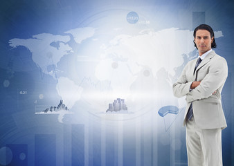 Businessman standing against the digital world map