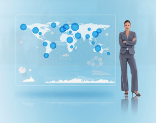 Businesswoman standing near to a futuristic screen