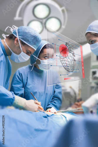 Surgeons using an interface for operating