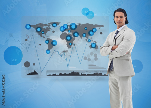 Serious businessman standing with a digital world map