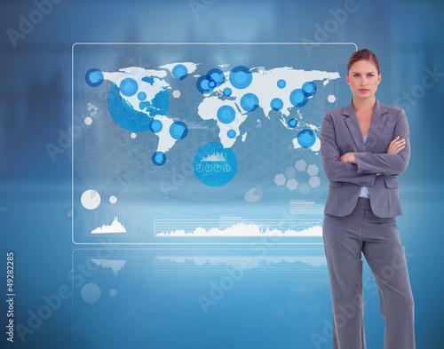 Businesswoman standing against a futuristic screen