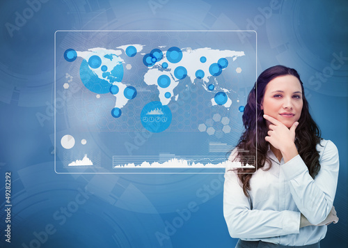 Businesswoman looking at statistics in the world