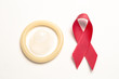 Red awareness ribbon and condom