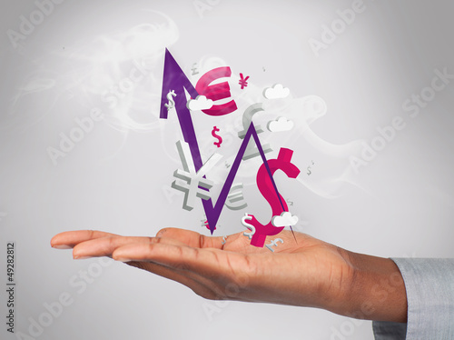 Businessman holding smoking currency and arrow in his hand