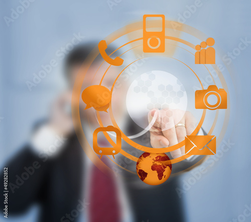 Businessman using orange wheel interface for computer applicatio