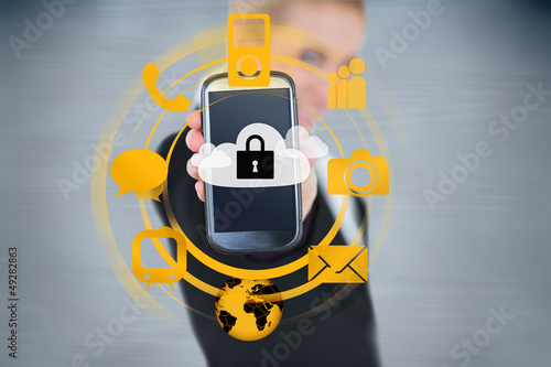 Businesswoman holding up locked smart phone with orange applicat