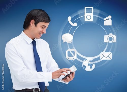 Businessman using tablet with applications