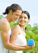 Cheerful couple with dumbbells on workout