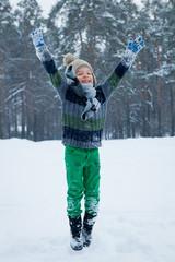 Portrait of boy with skates, winter