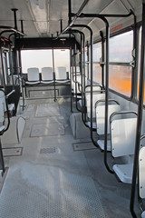 empty seats inside the bus for transport of persons