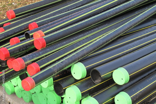 piles of plastic pipes and conduits for transporting the  gas