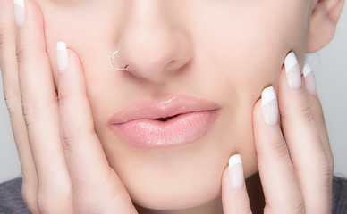 Natural Makeup and French Manicure. Sensual Lips