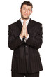 young businessman praying with his hands set in pray