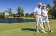 Happy Senior Couple Playing Golf