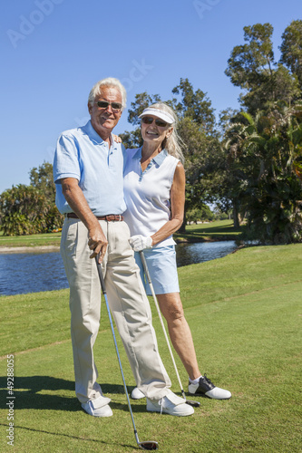 Happy Senior Couple Playing Golf