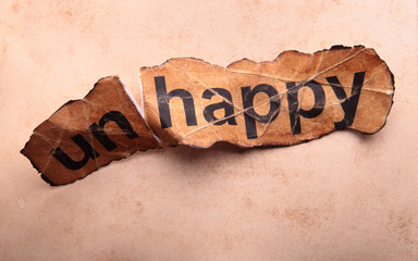 Word unhappy transformed into happy. Motivation