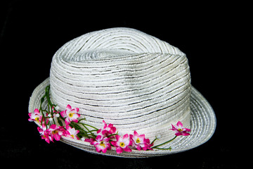 white classic hat with flowers
