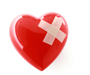 A red heart with adhesive plaster